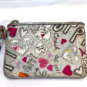 Coach Poppy wristlet, immaculately clean like new